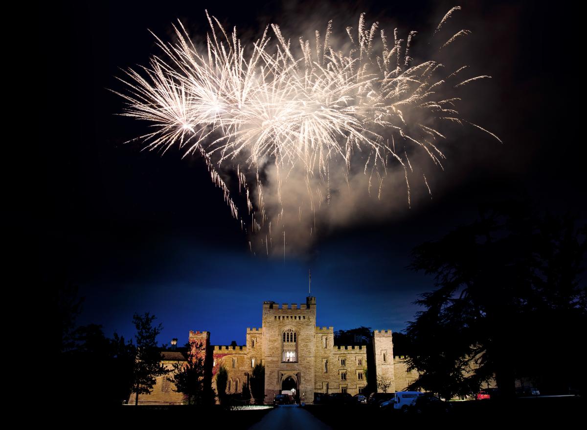 Fireworks exploding over Hampton Court Castle.
