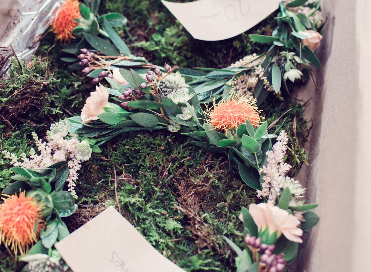 A crown of flowers laid out on moss