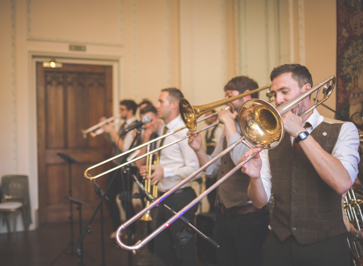 A trombonist plays as part of a brass band