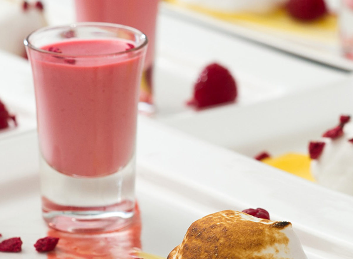 Raspberry dessert in a glass, on a plate.
