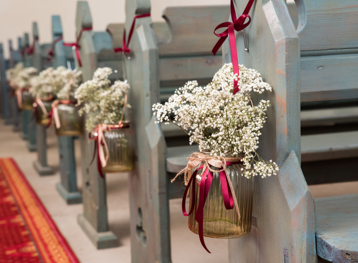 Gypsophilia in jars, hanging from the end of pews.