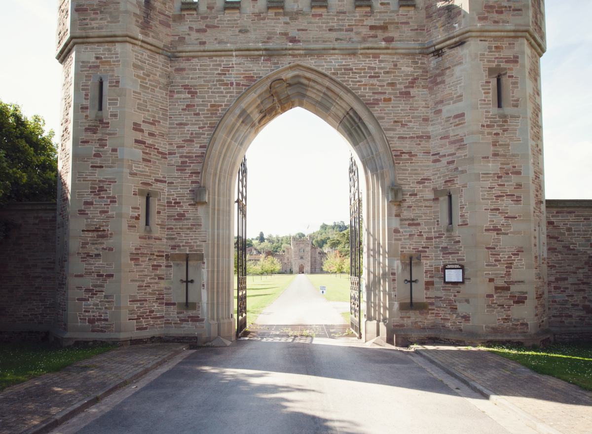 A gateway with a drive leading straight down to a castle