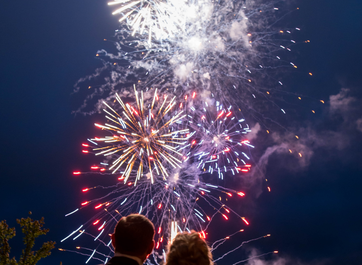 A couple watching fireworks