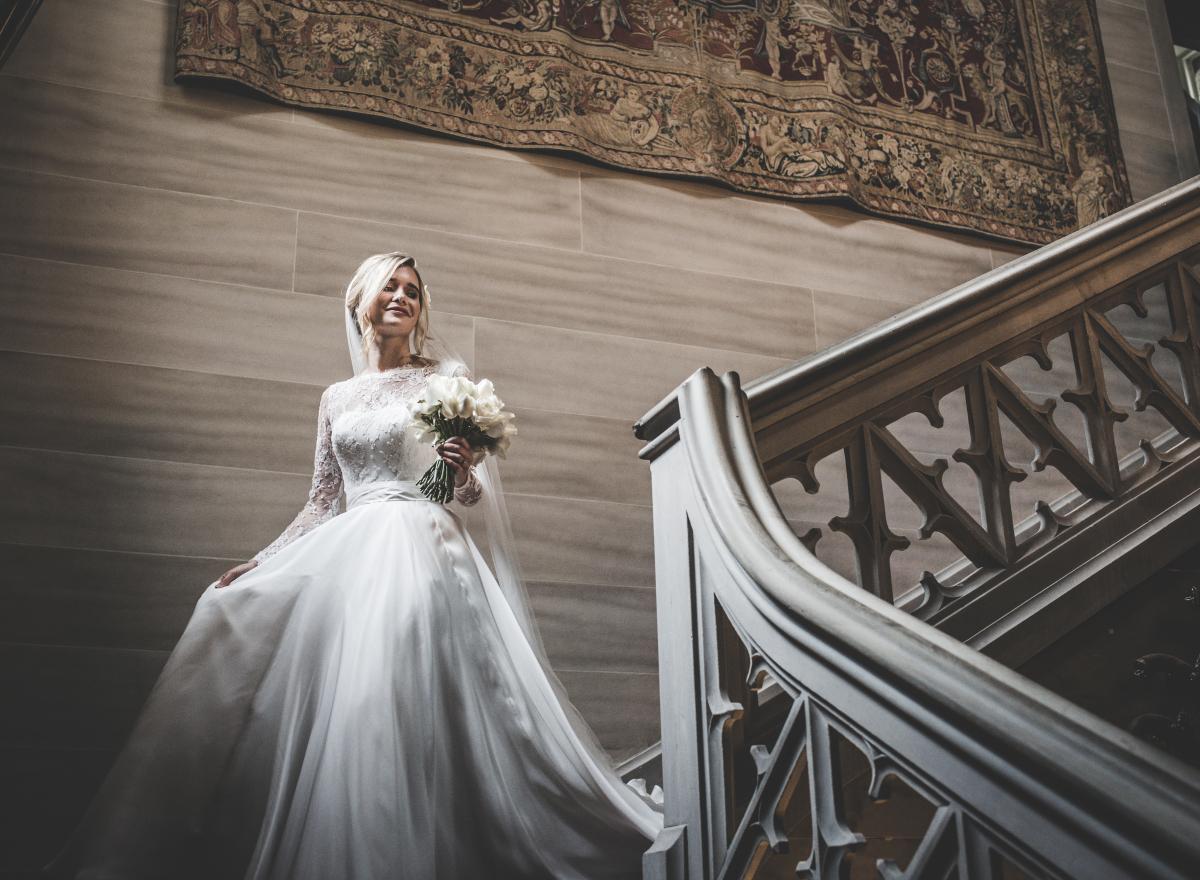 A bride descending a staircase
