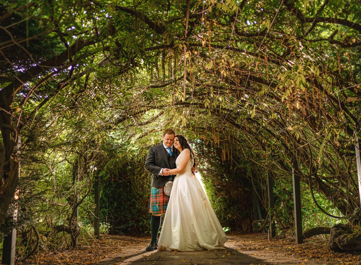 Couple in Wisteria Arch
