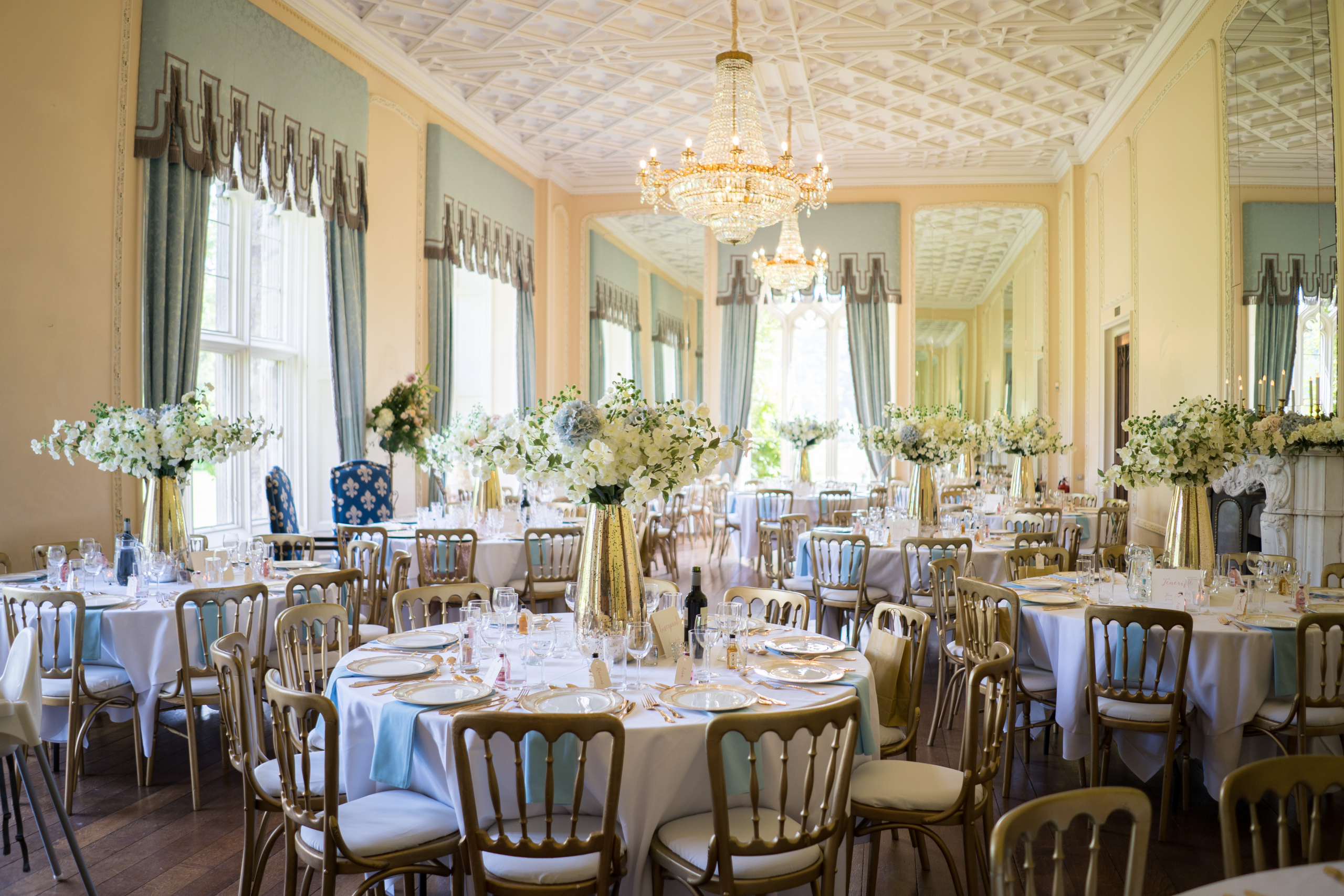 Ballroom with laid up tables and flowers